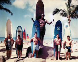 Surfers with Duke Kahanamoku Statue