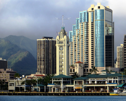 Aloha Tower Marketplace Set Against the Backdrop of Downtown Honolulu as Seen from Sand Island