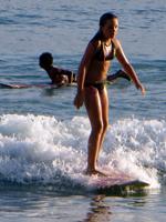 Girl Surfing in Hawaii at Waikiki Beach