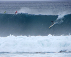 Surfing in Hawaii: Dropping in on a Big Wave at Waimea Bay