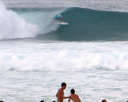 Matt Wilkinson Exits a Perfect Tube Close to Spectators on the Shore at Pipe Masters Triple Crown of Surfing