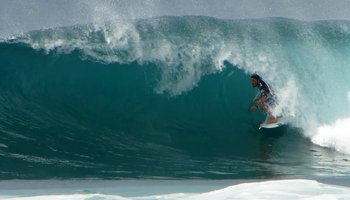 Unidentified Surfer inside a Backdoor Tube at the Billabong Pipe Masters Triple Crown of Surfing