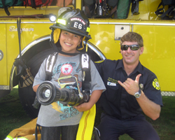 My Son Showing the Firefighter How Things Work at Bishop Museum Healthy Kids Day