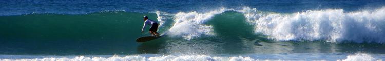 Longboarder Surfing in Hawaii at Hau Bush in Ewa Beach