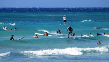 Crowds Surfing in Hawaii at Waikiki Beach