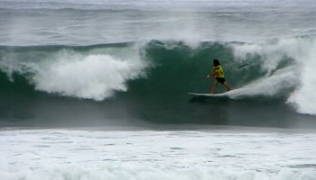 Kaito Ohashi prepares to launch into a floater at the 2013 Reef Hawaiian Pro, Vans Triple Crown of Surfing