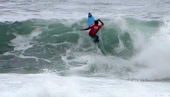 Marco Fernandez prepares to snap off the lip at the 2013 Reef Hawaiian Pro, Vans Triple Crown of Surfing