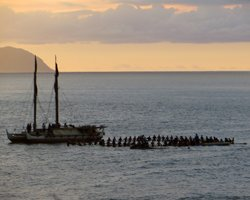 Circle of Invitees Next to Hokulea at the Eddie Aikau Big Wave Invitational Opening Ceremony, Waimea Bay, Oahu